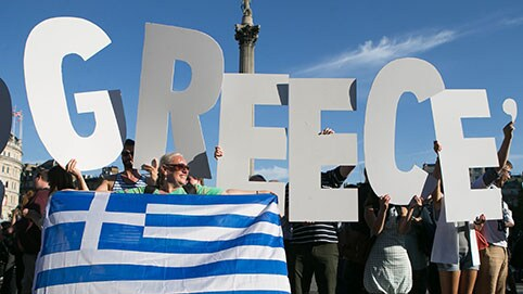 Greece concedes to bailout demands